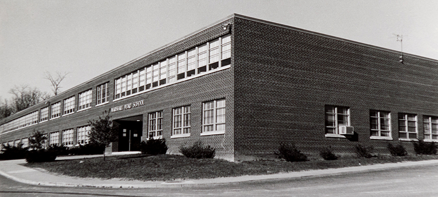 Black and white photograph of the front side of Marshall Road Elementary School, taken circa 1968. The trees and shrubs in front of the building are very small and look to have been planted on a few years prior.