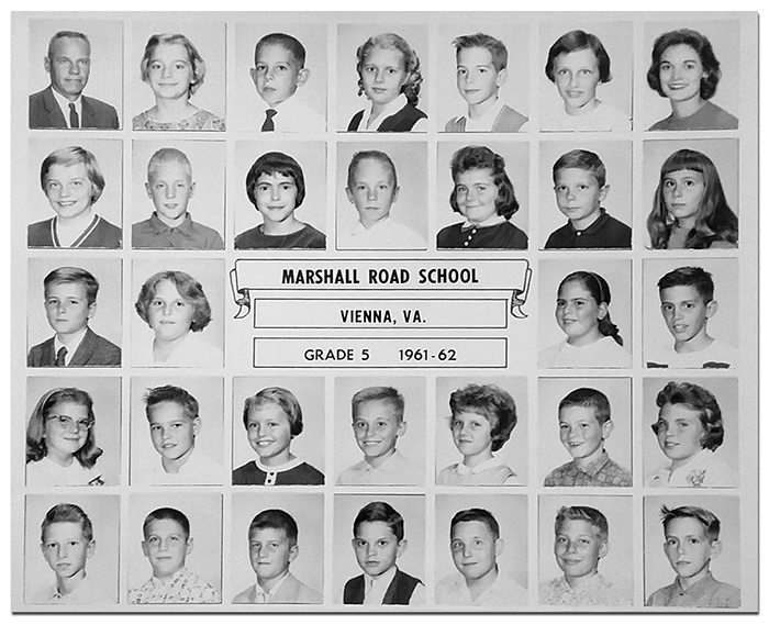 Black and white class photograph showing a grade five classroom at Marshall Road Elementary School from the 1961 to 1962 school year. Among those pictured is Dottie Gabig. The principal, Robert F. Jarecke, can be seen in the top left corner. There were 30 children in the class.